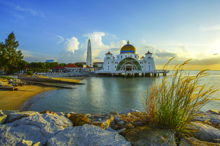 straits: Majestic view of Malacca Straits Mosque during beautiful sunset.
