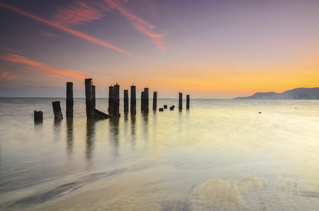 vibrant colour: Old broken pier during awesoome beatiful sunset. Vibrant colour Stock Photo