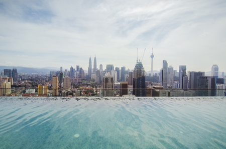 Swimming pool on roof top with beautiful city view. Kuala-Lumpur, Malaysia. Stock Photo