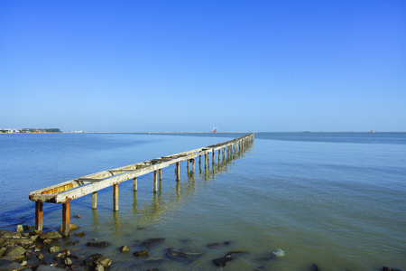 space   area: wooden pier in caribbean sea with beautiful blue sky and copy space area.