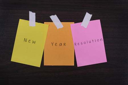 message board: Motivational Concept Image of message note paper pinned on cork board with New Year Resolution words written on it Stock Photo