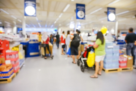 checkout counter: Blur image view of cashier with a line of people at the check-out counter Stock Photo