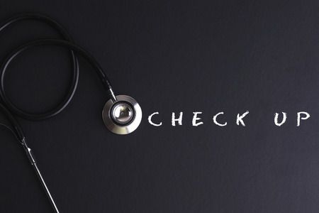 CHECK UP word with stethoscope - health concept. Medical conceptual