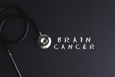 brain cancer: BRAIN CANCER word with stethoscope - health concept. Medical conceptual Stock Photo