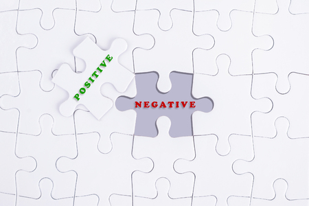 negative area: Missing white puzzle with POSITIVE NEGATIVE word and copyspace area