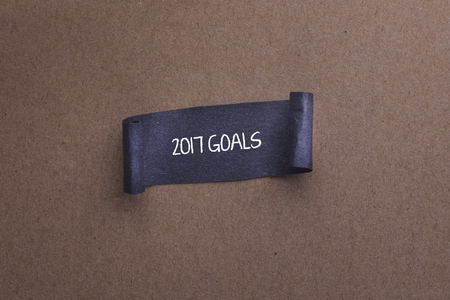 money matters: Black papper with 2017 GOALS word on wooden background Stock Photo
