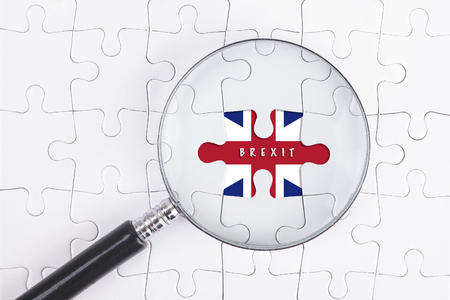scepticism: Business Concept - Magnifier Glass on white puzze with BREXIT Word