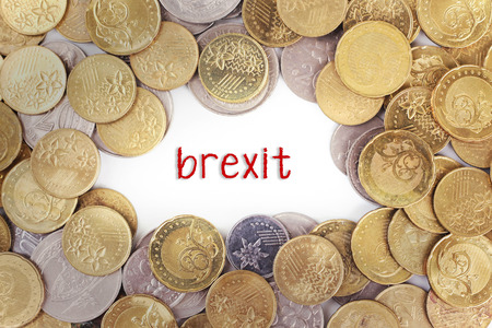 scepticism: Background of the gold coin with word brexit in the middle