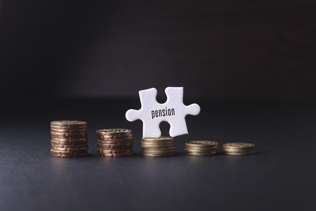 leading education: White missing puzzle and gold coins with pension word ,copyspace area Stock Photo