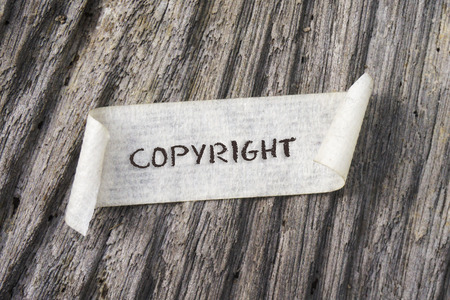 conservancy: TORN paper with COPYRIGHT word on wooden background. GRAIN AND RUSTIC EFFECT. Stock Photo