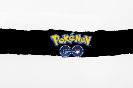 Kuala Lumpur, MALAYSIA - JULY 15TH, 2016: Pokemon Go on torn paper. Pokemon Go is a free-to-play augmented reality mobile game developed by Niantic for iOS and Android devices Editorial