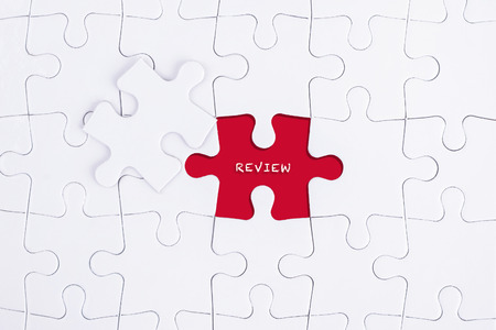 approval rate: Missing white puzzle with REVIEW word and copyspace area