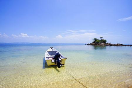 perhentian: Fisherman boat on a tropical beach, Pulau Perhentian, Malaysia.