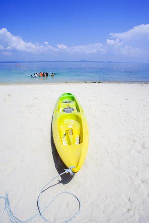 Kayak on sunny tropical beach