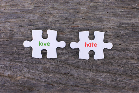 hate: Puzzle with a love inside and hate Stock Photo