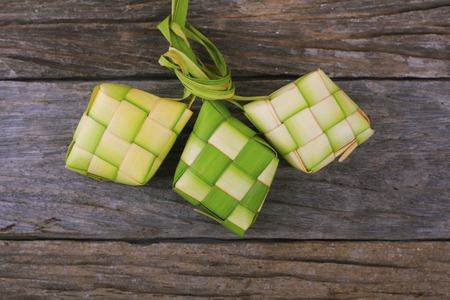 Ketupat (rice dumpling) is a local delicacy during the festive season in South East Asia. Ketupat, a natural rice casing made from young coconut leaves for cooking rice..