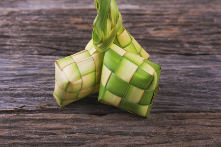 the casing: Ketupat (rice dumpling) is a local delicacy during the festive season in South East Asia. Ketupat, a natural rice casing made from young coconut leaves for cooking rice.. Stock Photo