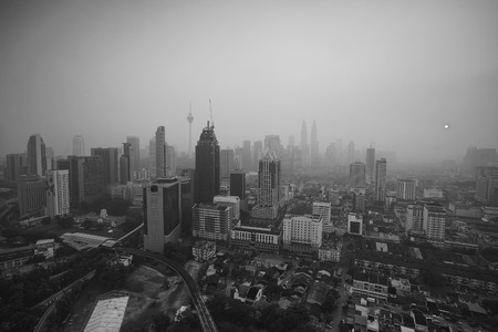 Smoke from forest fires in Indonesia blows across the Malay Peninsula causing haze in Kuala Lumpur