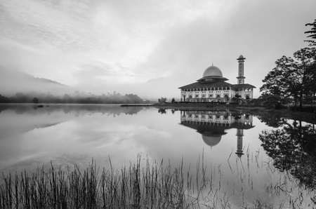 mid morning: Reflection of a beautiful mosque in black and white
