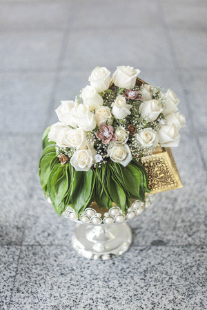 Wedding bouquet of white roses and  on wooden floor Stock Photo