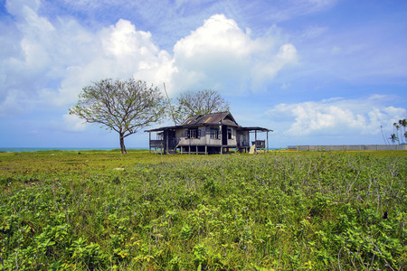 prairie: Old abandoned house under blue sky near the beach Stock Photo