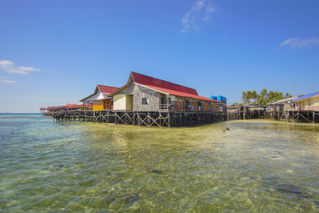 resort life: Small chalet in a crystal clear water in Mabul Island semporna sabah