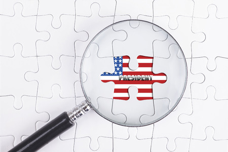 Business Concept - Magnifier Glass on white puzze with PRESIDENT Word
