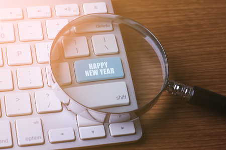 initiatives: Currency concept: HAPPY NEW YEAR on computer keyboard background