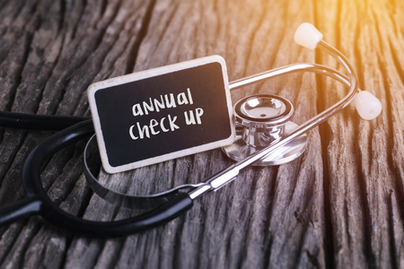 doctor burnout: Stethoscope on wood with annual check up word as medical concept Stock Photo