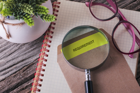 Business Concept : REQUIREMENT written on envelope with wooden background Stock Photo