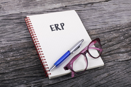 erp: Note with ERP on the wooden background