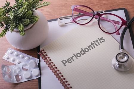 Periodontitis: Stethoscope on note book with Periodontitis words as medical concept Stock Photo