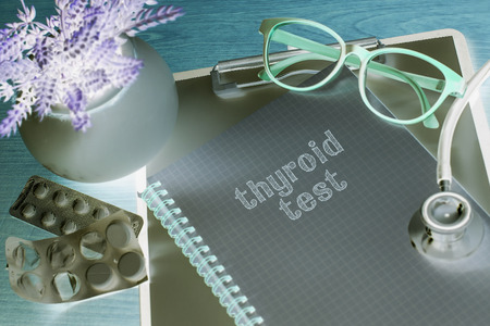 Stethoscope on note book with thyroid test words as medical concept Stock Photo