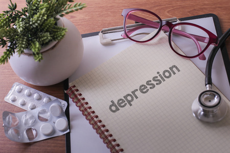 Stethoscope on note book with depression words as medical concept Stock Photo