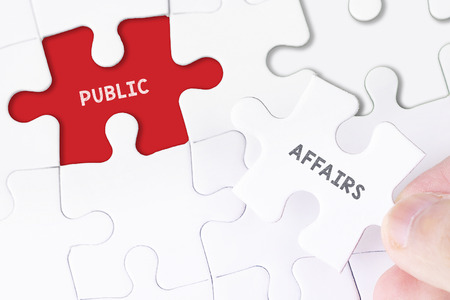 public welfare: Female hand and missing puzzle with PUBLIC AFFAIRS WORD Stock Photo