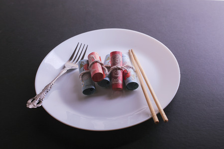one hundred dollars: Conceptual composition, white plate full of malaysia money Stock Photo