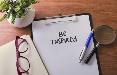 influencer: Be Inspired word on paper with glass ballpen and green plant Stock Photo