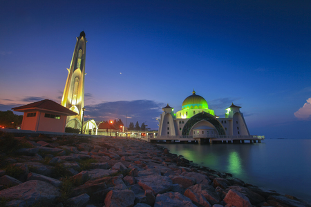 spiritual architecture: Blue hour at beautiful Malacca Straits Mosque with moon at background
