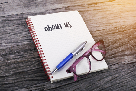 about us: Note with about us on the wooden background Stock Photo