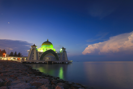 Blue hour at beautiful Malacca Straits Mosque with moon at background