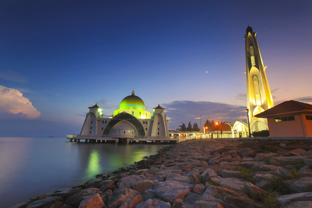 istanbul beach: Blue hour at beautiful Malacca Straits Mosque with moon at background
