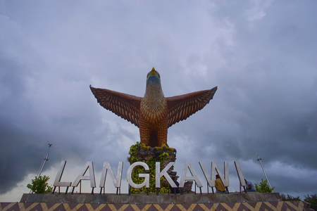 LANGKAWI, MALAYSIA - 15 JUNE 2017 - Beautiful sunset at Eagle Square, Dataran Lang is one of Langkawi's best known man-made attractions, a large sculpture of an eagle poised to take flight. Stock Photo