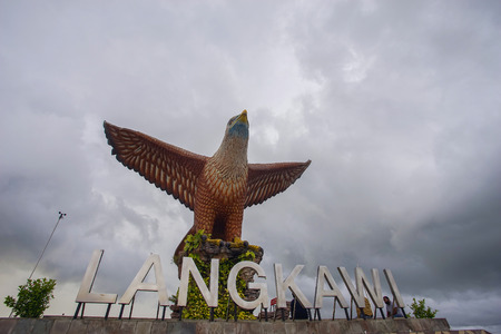 poised: LANGKAWI, MALAYSIA - 15 JUNE 2017 - Beautiful sunset at Eagle Square, Dataran Lang is one of Langkawi's best known man-made attractions, a large sculpture of an eagle poised to take flight. Stock Photo
