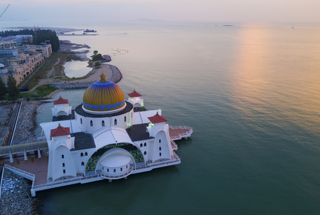 arial view: Majestic view of Malacca Straits Mosque during sunset.