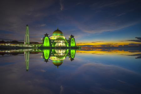 Strait mosque during beautiful blue hour Stock Photo