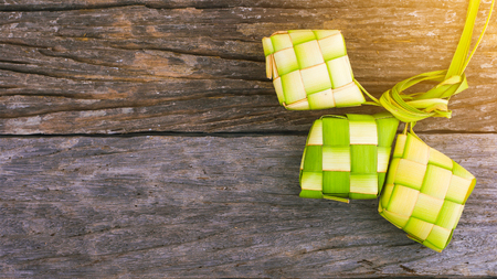Ketupat (rice dumpling) is a local delicacy during the festive season in South East Asia. Ketupat, a natural rice casing made from young coconut leaves for cooking rice.. Stock Photo