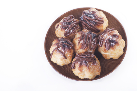 Chocolate cream puff isolated on white background