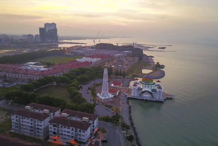 Aerial view of Majestic Malacca Straits Mosque during sunrise