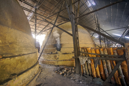 Scenery of traditional charcoal factory Editorial