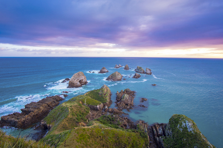 Beautiful and dramatic long exposure shot of sunrise At Nugget Point lighthouse, Caitlins, south Island of New Zealand Stock Photo
